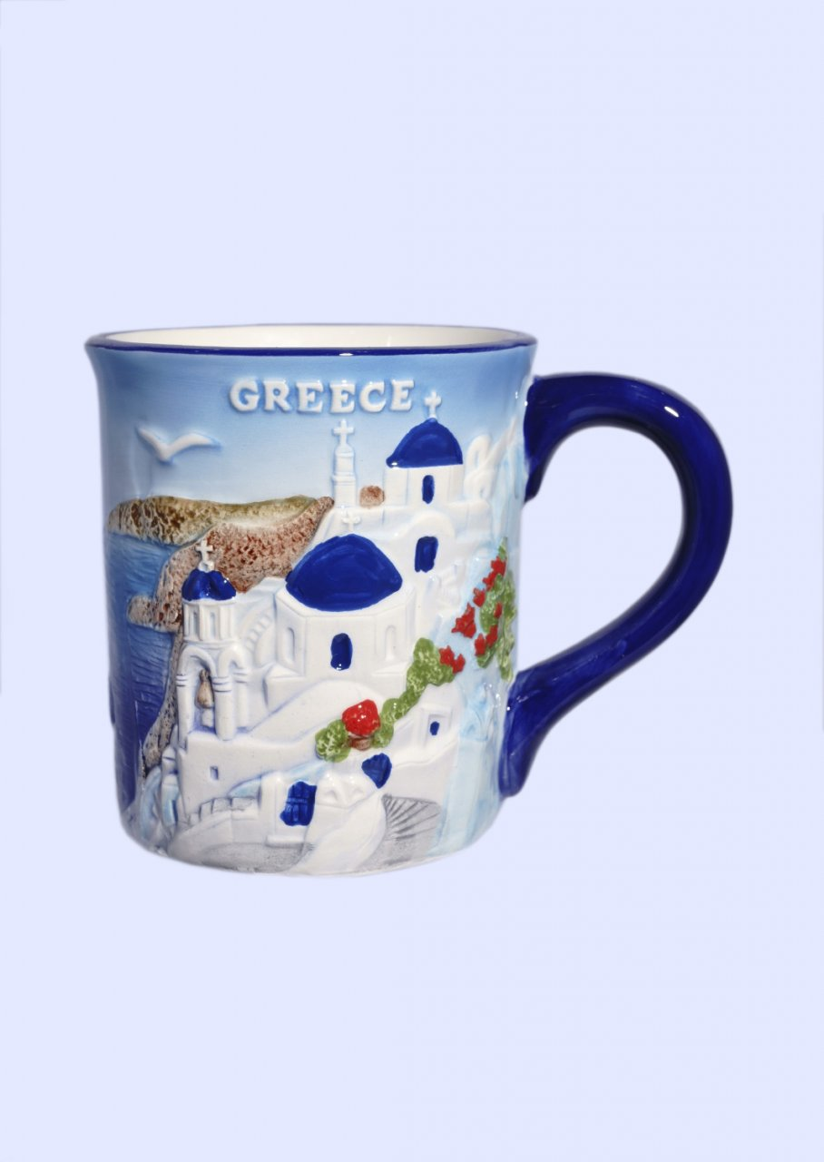 Porcelain mug decorated with a relief of the greek island of Santorini