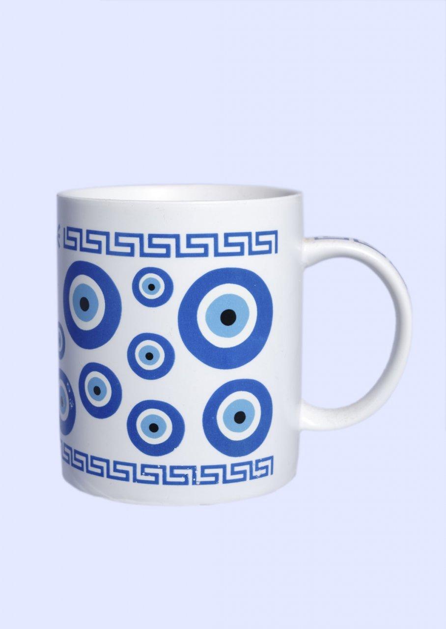 Porcelain mug with Evil Eyes and the Greek key design