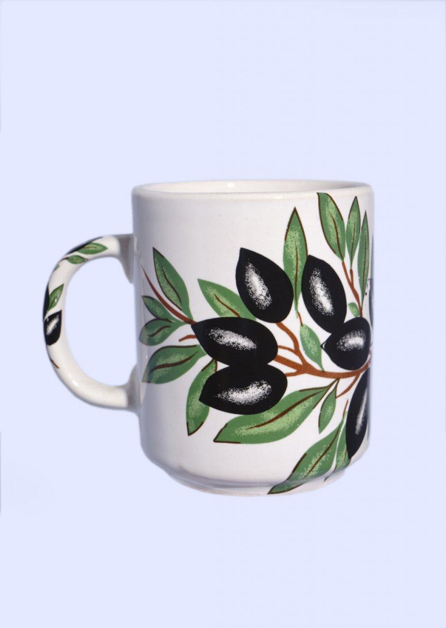 Porcelain mug with olives and olive leaves
