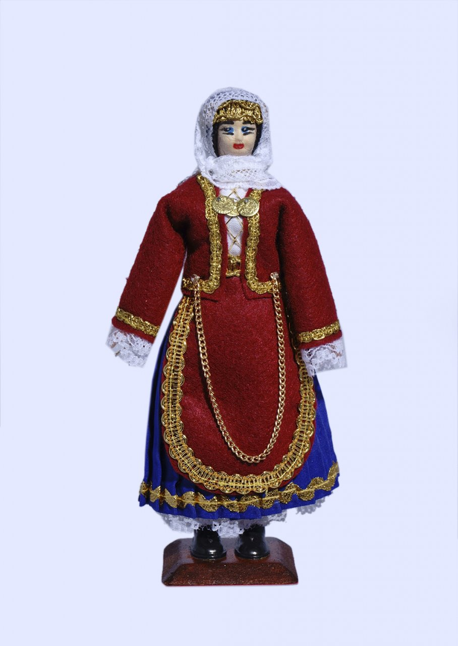 Handmade small doll of a greek woman dressed in traditional costume from Salamis