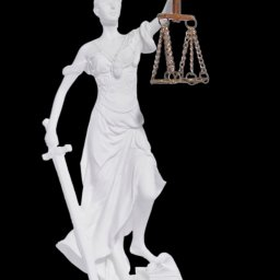 Themis the greek goddess of justice, holding the Scales of Justice and a sword 1