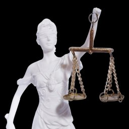 Themis the greek goddess of justice, holding the Scales of Justice and a sword 3